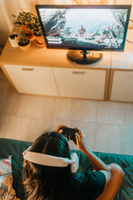 Unrecognizable Woman Gaming At Home