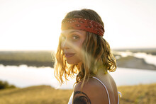 Backlight Portrait Of A Young Hippie Girl Outdoors