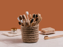 Set Of Bamboo Toothbrushes In Knitted Cup