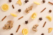 Ginger, Lemon, Cinnamon Sticks And Star Anise On Beige Background