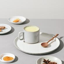 Turmeric Latte And Ingredients - Milk, Ginger, Cinnamon. Ayurveda Treatment. Immune Booster Concept.