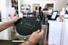 Wine: Shop Owner Holds Open Sign For Business
