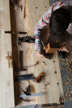 Carpenter Using A Chisel And Mallet