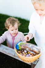 Big Brother And Little Sister In Pajamas Outdoor For Easter Hunt