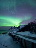 Surreal aurora sky at the arctic coast of Norway
