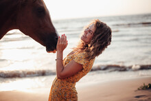 Portraits Of A Young Woman Riding Horse On A Summer Day