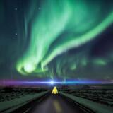 Surreal northern lights road scene