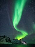 Wild northern lights dancing over nordic mountains