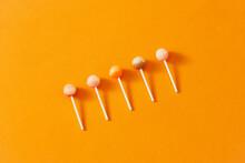 Caramel On A Stick On A Orange Background