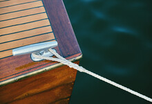 Wooden Boat Detail With Mooring Rope