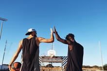 Friends High-fiving After Basketball