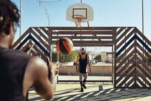 Friends Shooting Hoops In The Summer