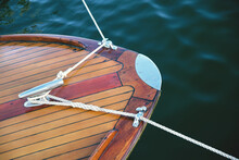 Vintage Wooden Boat With Mooring Ropes