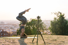 Anonymous Female Shooting Video For Yoga Blog