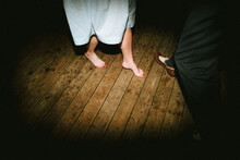 Close Up Of Girl Dancing Barefoot With Boy Wearing Shoes