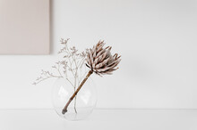 Dried Flowers In Vase On Table