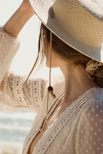 Trendy Young Woman Wearing A Hat Looking Into The Sun