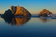 USA, Oregon, Bandon. Sunset On Beach Sea Stacks.