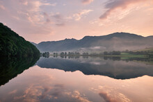 Mist And Reflections At Dawn. Brothers Water, Lake District, Cumbria, UK.