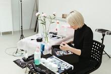 A Woman Tattoo Artist In A Tattoo Studio.