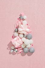 Christmas Presents. Xmas Balls White, Silver Color, In A Tree Shape And Gift Boxes Against Pastel Pink Background