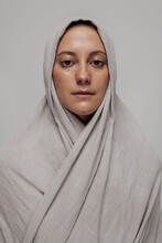 Girl In A White Clothes Monk Studio Looking At Camera Caucasian Face Portrait