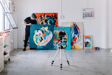 Artist Photographing His Work At Studio