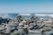 Smooth Round Stones On Rocky Beach