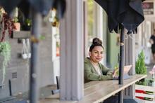 Aboriginal Woman In Cafe