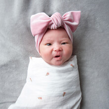 Cute And Funny Expression Of A Mixed Race Baby