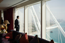 Businessman Looks Out Window In Dubai