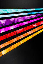 Colorful Inked Papers On Black Background