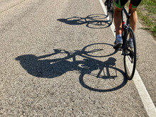 Cyclists And Their Shadow