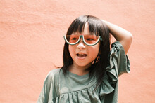 Portrait Of Cute Little Girl With Fashion Sunglass