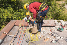 Working At Elevations. Rope Access, High-altitude Outdoor Work.