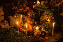 Small Skeleton Dolls Adorn A Family Grave