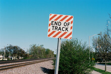 End Of Track Sign By A Railroad
