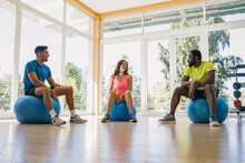 People On Exercise Balls Chatting