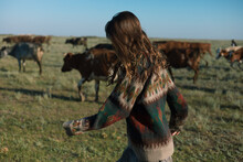 Girl On The Background Of Cows