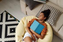 Girl Falling Asleep With Book