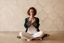 Barefoot Woman Meditating With Beads In Clasped Hands
