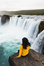 Person Enjoying Waterfall