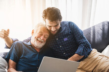 Senior Father Hugging Adult Son, Aged Father And Hipster Son Living Together At Home, Hug And Happy Relation Lifestyle, Fatherhood Activity Indoor At The House, 2 Man Person Family Elderly Generation