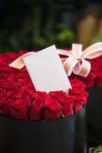 The Plain White Paper Card In A 101 Red Roses Bouquet