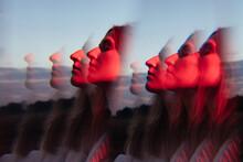 Kaleidoscop. Portrait In Red Neon Light.