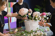 World Of Floristry, One Day At The Flower Shop. A Team Of Florists Arranges Flowers Into A Rich Bouquet