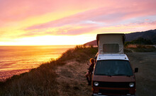 Wanderlust Woman Recording A Beautiful Sunset Over The West Coast Of California During A Roadtrip With Her Vintage Campervan