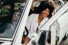 Black Woman Sitting In A White Vintage Car