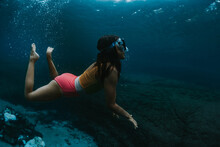 Girl Explores Underwater World