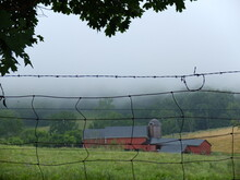 Red Barn Through Barbed Wire